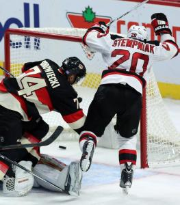 Lee Stempniak celebrates his game-tying goal with 32 seconds left in regulation. He also won the game in a shootout giving the Devils a 5-4 win over the Senators.  AP Photo by Fred Chartrand/The Canadian Press
