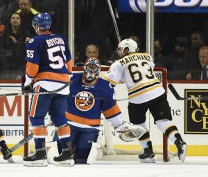 Jaroslav Halak and Johnny Boychuk can't look after Brad Marchand scores the winner in a Bruins 2-1 win over the Islanders. AP Photo by Kathy Kmonicek/Getty Images