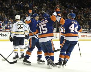 Islanders defenseman Calvin de Haan is congratulated by Cal Clutterbuck after scoring against the Sabres. The Isles lost 2-1. AP Photo by Kathy Kmonicek/Getty Images