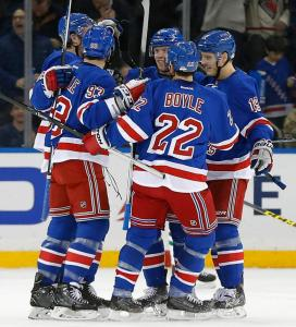 Keith Yandle celebrates a goal with teammates during the first period of a 6-2 win over the Stars. AP Photo/Julie Jacobson/Getty Images
