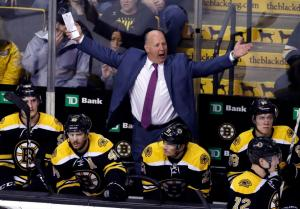 Boston Bruins head coach Claude Julien complains to officials after a call against the Bruins in the third period of an NHL hockey game against the Florida Panthers, Thursday, March 24, 2016, in Boston. (AP Photo/Elise Amendola)