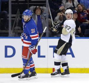 Pittsburgh Penguins' Sidney Crosby, right, and New York Rangers' Derek Stepan react after Crosby scored the game winning goal during the overtime period of the NHL hockey game, Sunday, March 27, 2016, in New York. The Penguins defeated the Rangers 3-2. (AP Photo/Seth Wenig)