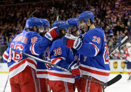 New York Rangers' Mats Zuccarello (36) celebrates with teammates Derick Brassard (16) and Henrik Lundqvist (30) after scoring a goal during the second period of an NHL hockey game against the Florida Panthers, Monday, March 21, 2016, in New York. (AP Photo/Frank Franklin II)