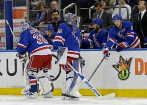 New York Rangers' Derek Stepan (21) encourages goalie Henrik Lundqvist (30) as goalie Antti Raanta (32) replaces Lundqvist during the second period of the Rangers' NHL hockey game against the Buffalo Sabres on Saturday, April 2, 2016, in New York. (AP Photo/Frank Franklin II)