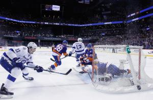 Following a big hit delivered on Thomas Hickey, Brian Boyle did in the Islanders by scoring the overtime winner in Game Three. The Lightning lead the second round series 2-1.   AP Photo by Bruce Bennett/Getty Images
